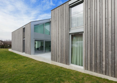 56030274 - exterior of a modern house in cement and wood, lawn